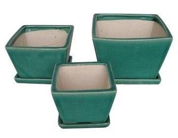 фотография керамического горшка зеленого цвета